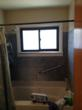 Bey bathroom before the bath to shower conversion - high tub rail that presented a safety challenge